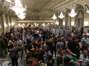 A packed house checks out scientific posters.