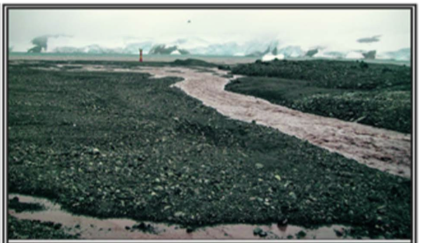 Figure 3 – Photo of a glacier meltwater stream. Sediments and pebbles are carried along with meltwater streams every summer. As temperatures have warmed, the streams have gotten stronger and deposited more particles into the ocean. (Figure 1b in the paper.)