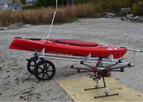 Figure 2: In the back is the kayak which has been given its own motor and will collect the samples. In front is a different octocopter that was considered for use (Jordan Kirby 2016).