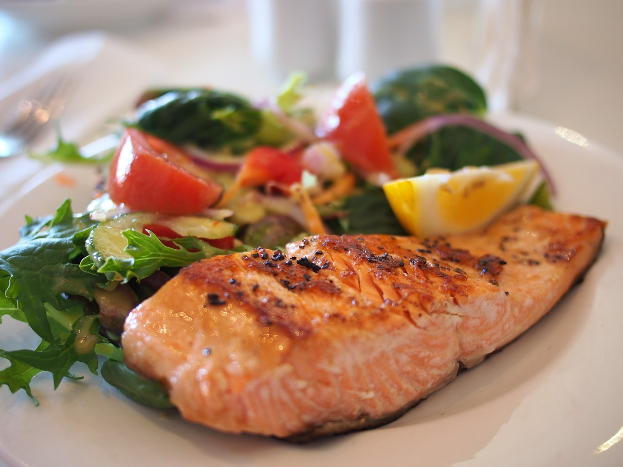 How is the changing diet of farmed Atlantic salmon affecting their nutritional value?