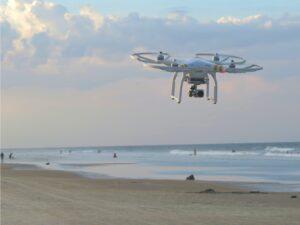 Drone flies over ocean