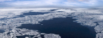Image of a birds-eye view of the Arctic ocean basin. There is open water surrounded by chunky sea ice.